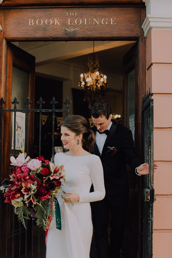 Bride and groom leaving The Book Lounge