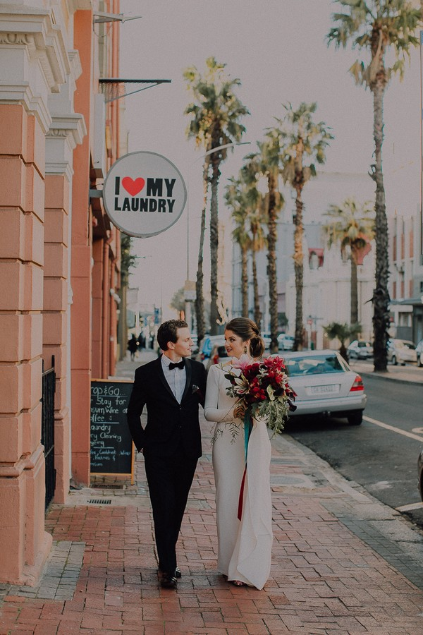Bride and groom walking in Cape Town