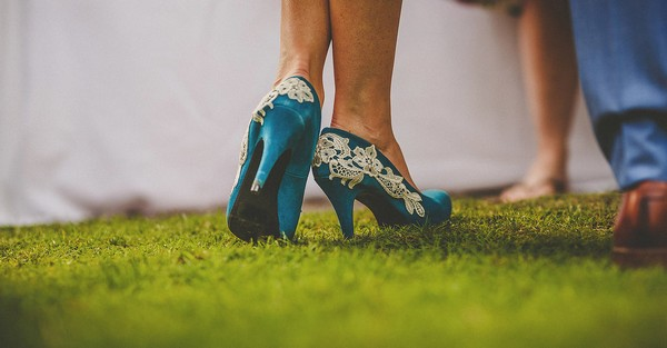 Bride's blue wedding shoes with white lace detail