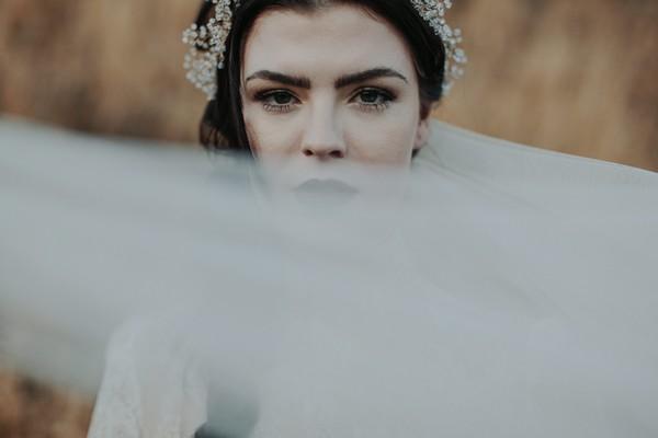 Bride's veil across her face