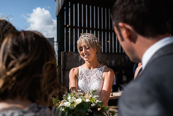 Bride showing guest her bouquet
