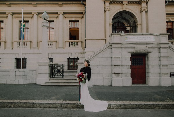 Bride wearing black shrug outside Centre for the Book