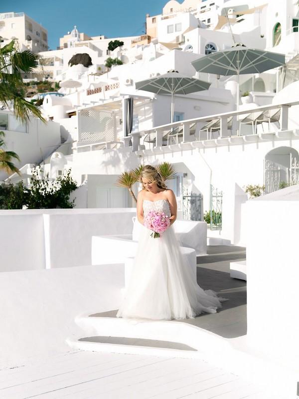 Bride arriving at wedding ceremony in Santorini