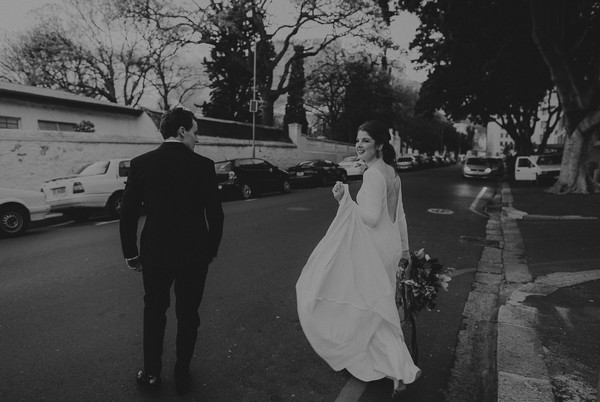 Bride and groom crossing the road