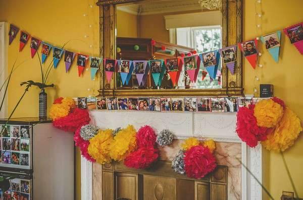 Bunting and pom poms around fireplace at Colehayes Park