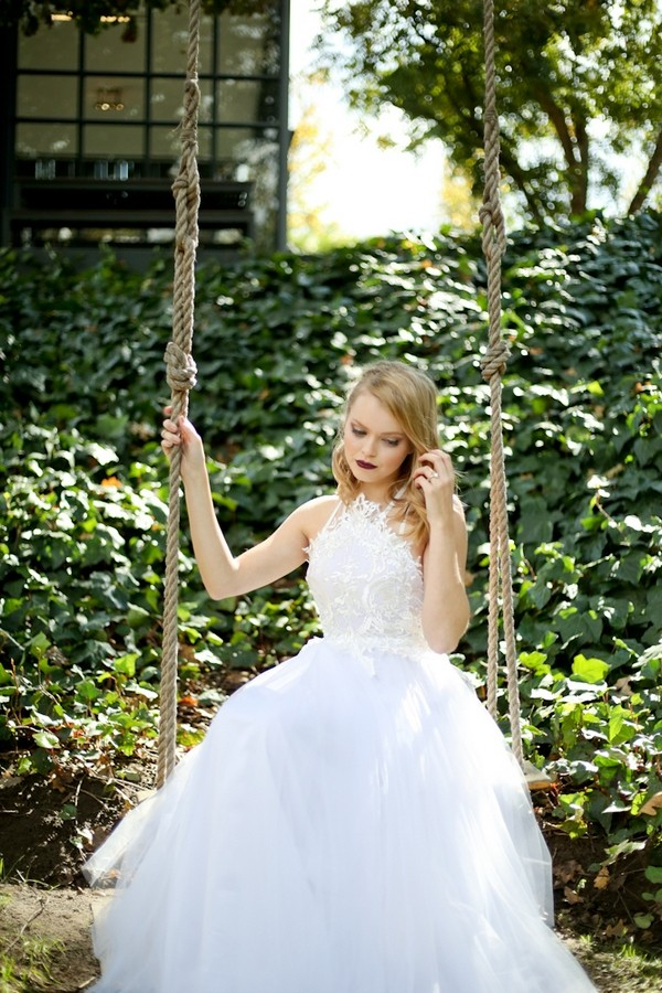 Bride sitting on swing