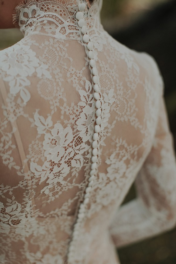 Lace detail and buttons on back of bride's dress