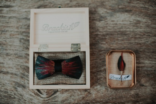Bow tie and feather buttonhole