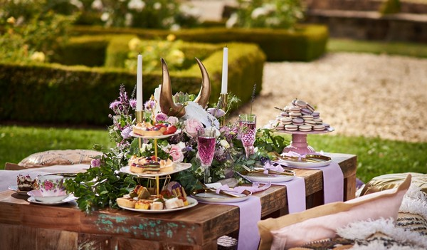 Large timber table with lavender wedding styling