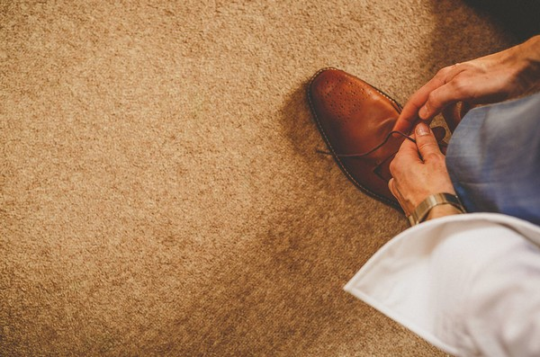 Groom tying shoelaces