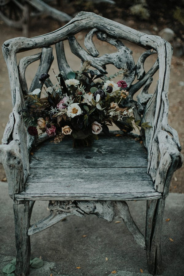 Bride's autumn bouquet on old wooden chair