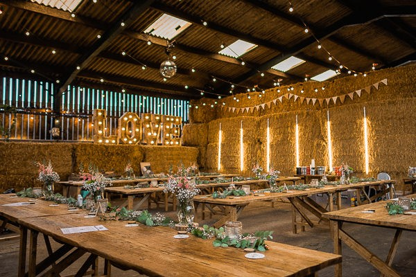 Wedding tables in cow shed