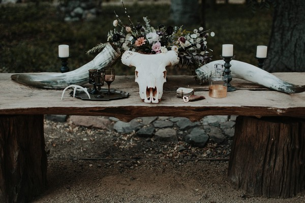 Animal skull and flowers on table