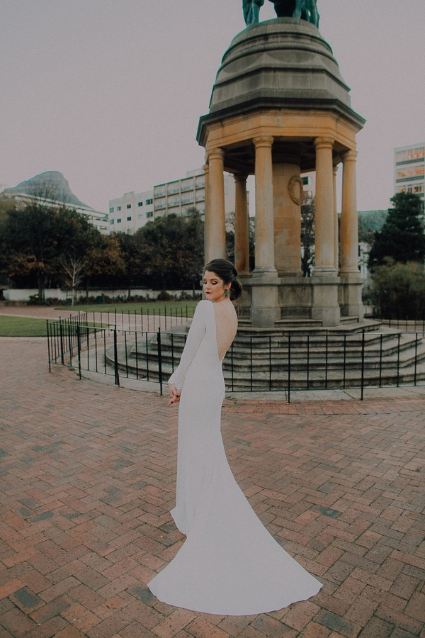 Bride standing by monument