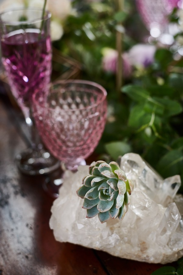 Succulent, clear quartz and purple glass on wedding table