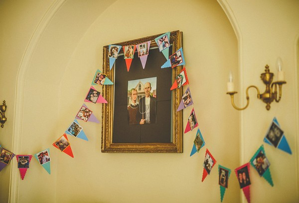 Picture on wall with bunting hanging from it
