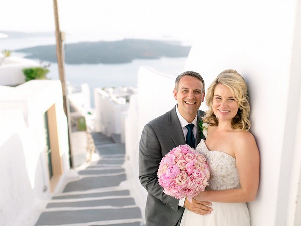 Bride and groom with Santorini street in background