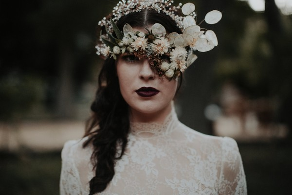 Bride with foliage mask over eyes