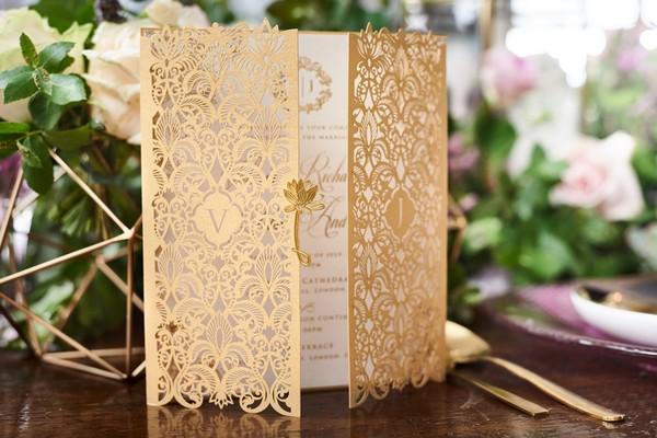 Gold laser-cut wedding stationery