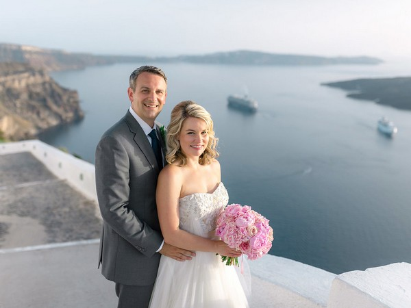 Bride and groom with sea in background