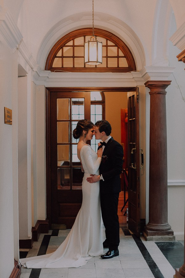 Bride and groom in hall of Centre for the Book