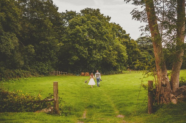 Bride and groom walking in grounds of Colehayes Park