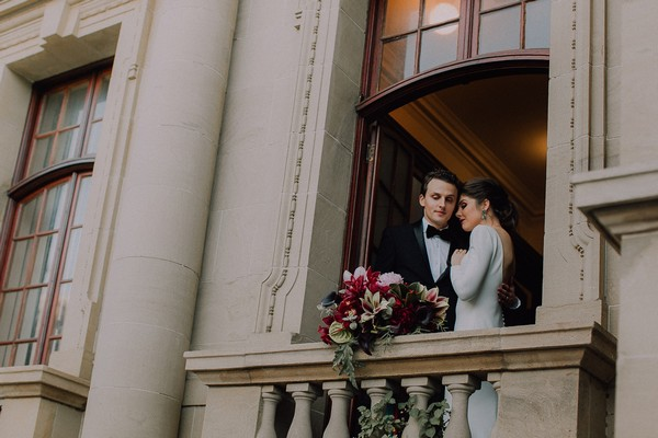 Bride and groom at balcony of Centre for the Book