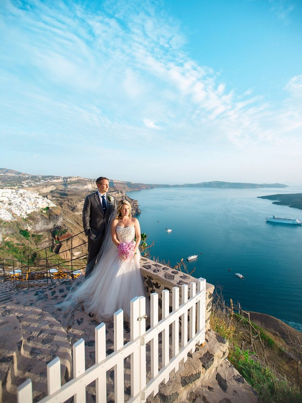 Bride and groom in front of view of Santorini