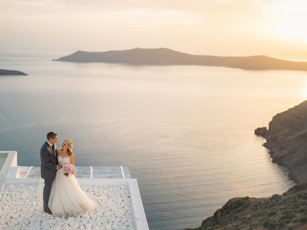 Bride and groom in front of sea