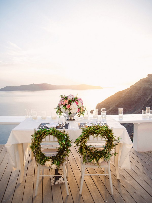 Small table for dinner after elopement in Santorini