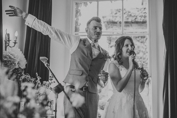 Bride and groom giving speech