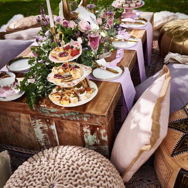 Outdoor wedding table display with cushion seating