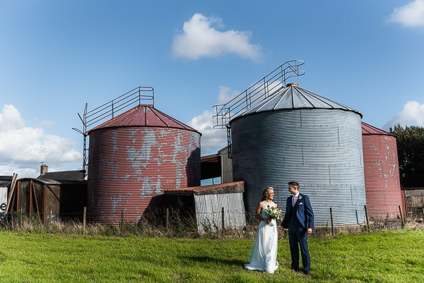 Bride and groom in front of milk tanks