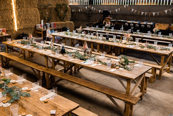 Rustic wedding table styling for cow shed wedding