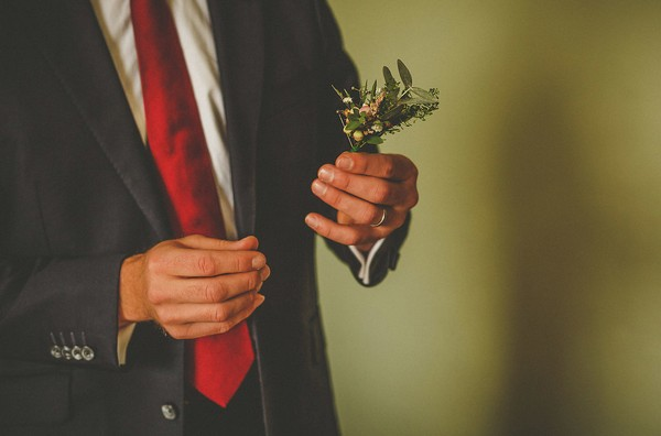 Man holding buttonhole