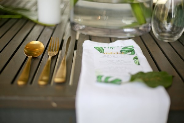 Gold cutlery at wedding place setting