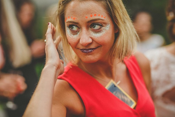 Wedding guest with face painted