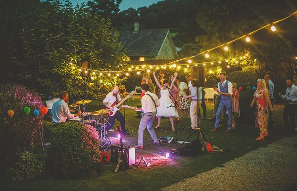 Wedding guests dancing to band