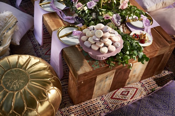 Lavender macarons on edge of wedding table