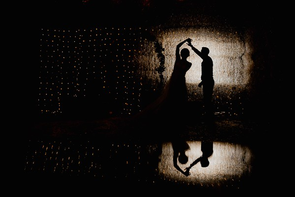 Silhouette of bride and groom dancing