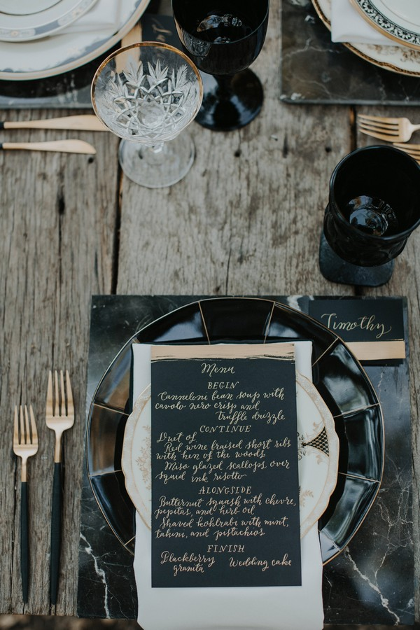 Black wedding menu at place setting