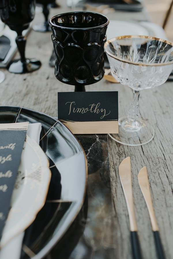 Black wedding name card with gold writing