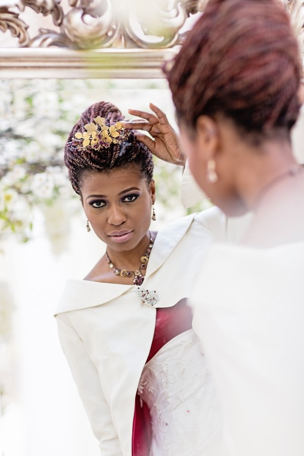 Bride Looking at Headpiece in Mirror