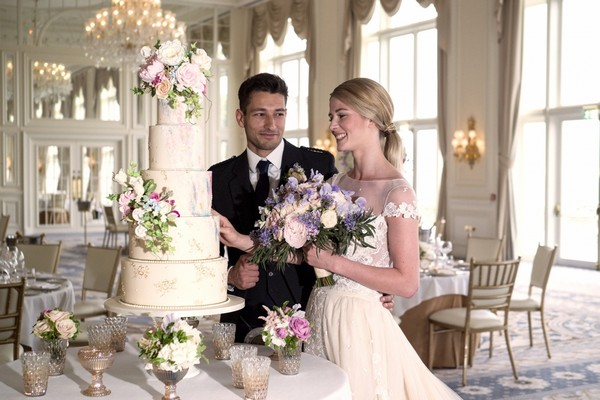 Bride and groom with wedding cake at Trump Turnberry