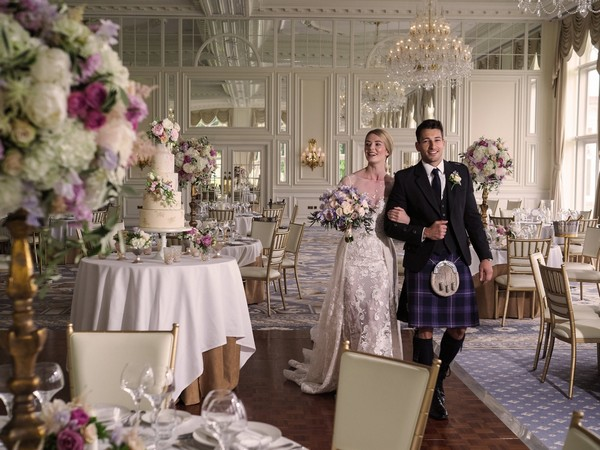 Bride and groom walking through ballroom at Trump Turnberry