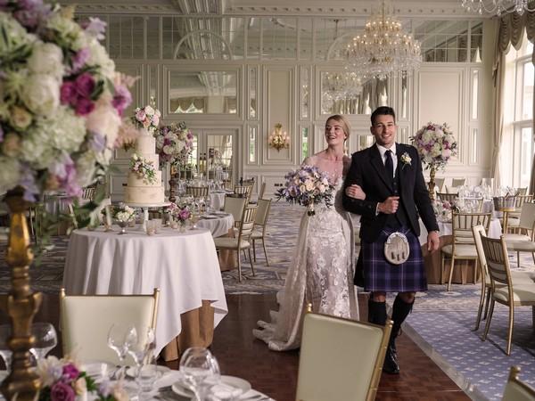 Bride and groom walking through ballroom at Trump Turnberry