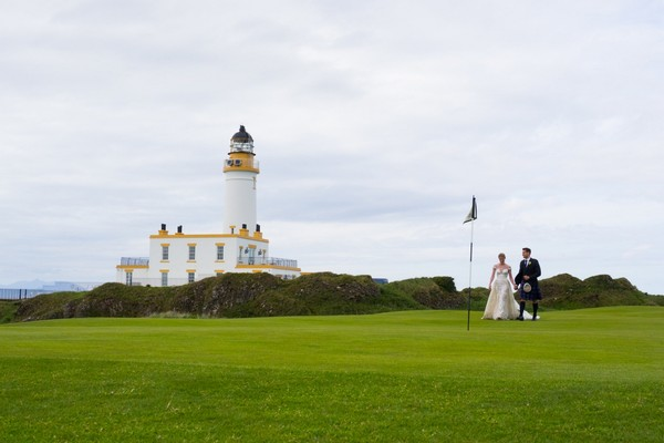 Bride and groom on golf course at Trump Turnberry