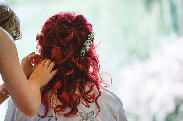 Hairdresser Adjusting Bride's Headpiece