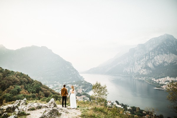 Bride and groom looking at view of Lake Como