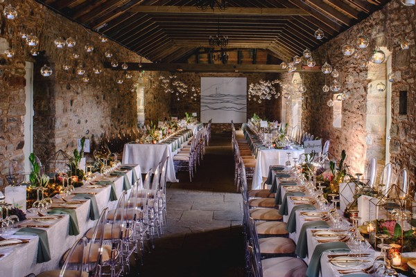 Tea Lights in Glass Baubles Suspended from Ceiling of Wedding Venue